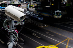 CCTV camera or surveillance operating on traffic. Road Stock Photo