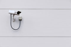 CCTV camera on wall with copy space Royalty Free Stock Image
