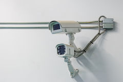 CCTV camera on wall Stock Photos