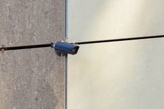 CCTV camera on the wall of a large building.  royalty free stock photo