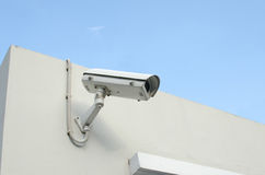 CCTV camera on a wall watch rigth Stock Images