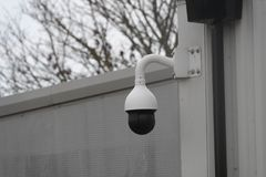 CCTV camera watches over property. A CCTV camera watches over property stock photos