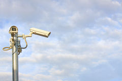 Cctv camera watching to viewers  and other side Stock Photos