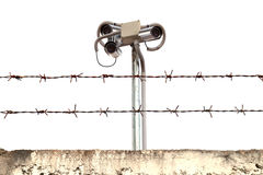 CCTV cameras. CCTV cameras in barbed wire fence Royalty Free Stock Photo