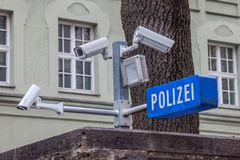 CCTV cameras on display next to a police station with a police sign in German: Polizei in the Bavarian city of Munich. Royalty Free Stock Photos