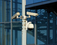 Cctv cameras on front of modern glass building Royalty Free Stock Image