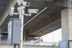 CCTV cameras installed along the road to security check. While driving on the road stock images