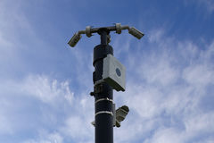 CCTV cameras on mast , blue sky with few clouds background. stock photo