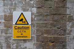 CCTV Caution Sign. On Vintage Brick Wall Royalty Free Stock Photo
