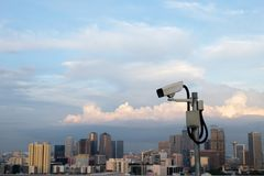 CCTV with cityscape background royalty free stock photo