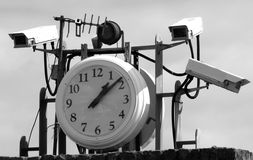 CCTV and a clock Royalty Free Stock Images