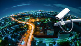 CCTV with fish eye perspective. CCTV with Blur City in background fish eye perspective stock photography