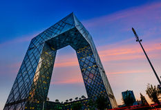 CCTV Headquarters. At twilight , The CCTV building is a loop of six horizontal and vertical sections with a total floor space of 473,000 square meters Stock Images