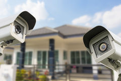 CCTV Home camera security operating at house. Royalty Free Stock Image