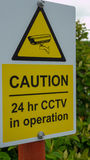 CCTV 24 hour Security Camera video surveillance sign. Warning people Stock Image