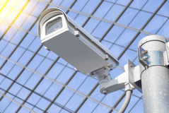 CCTV installed on the pole in front of the building windows. Royalty Free Stock Photo