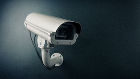Cctv-kamera på ögla för blinkande ljus för vägg arkivfilmer