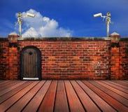 Cctv-Kamera und alte Backsteinmauer Lizenzfreie Stockfotos