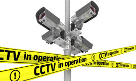 CCTV in operation. The concept. Four modern security camera mounted on a pillar and yellow warning tapes with inscription CCTV in operation. The three Stock Photos