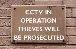 CCTV in operation sign. Warning sign with CCTV in Operation written on it which is used a method of crime prevention. The words are painted in white and on a stock photo