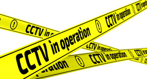 CCTV in operation. Yellow warning tapes Royalty Free Stock Photo