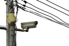 Cctv on power pole with power cord vector illustration