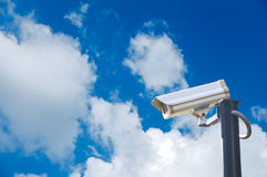CCTV security cam. On blue sky background Stock Photo