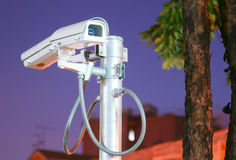 CCTV security cam on night background Royalty Free Stock Photo