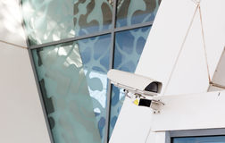 CCTV security came connected to top of airport entrance in Marra Stock Photo