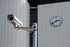 CCTV security camera. Against a city building Stock Photos