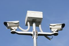 Cctv security camera on blue background. Property protection Royalty Free Stock Images