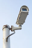 CCTV Security camera on blue sky background Royalty Free Stock Photography