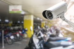 CCTV security camera in car or motorcycle park building.  royalty free stock photography