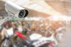 CCTV security camera in car or motorcycle park building.  stock image