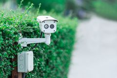 CCTV security camera in car park at garden. stock images
