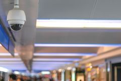 CCTV security camera on ceiling operating inside the building for crime protect stock image