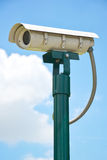 CCTV security camera, Close Circuit Television on blue sky. Royalty Free Stock Photos