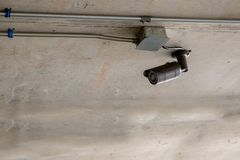 CCTV security camera.closed circuit camera surveillance on pole of office building Safety system. Area control in rainy day and copy space Concept for Security Stock Photos