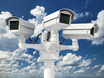 CCTV security camera on cloud sky background. Stock Photo