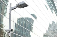 CCTV security camera lamp pole in the city Stock Photography