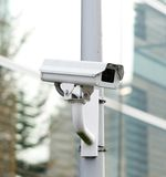 CCTV security camera looking and recording Stock Photo