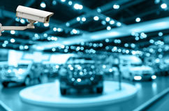 CCTV security camera on monitor the Abstract blurred photo of motor show Royalty Free Stock Photo
