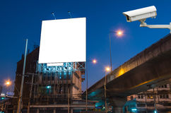 CCTV security camera on monitor the Blank billboard for advertis. Ement at twilight time Stock Image