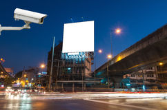 CCTV security camera on monitor the Blank billboard for advertisement at twilight time Stock Image