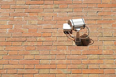 CCTV Security Camera.   mounted on the outdoors brick wall. Royalty Free Stock Photography
