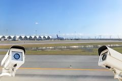 CCTV Security Camera operating in airport runway background. royalty free stock images