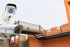CCTV Security Camera operating on big wall classic castle. The CCTV Security Camera operating on big wall classic castle blur background Stock Photo