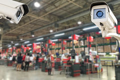 The CCTV Security Camera operating in counter service cashier at Royalty Free Stock Photo
