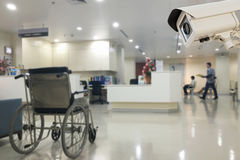 The CCTV security camera operating in office hospital blur backg. Round Stock Photo