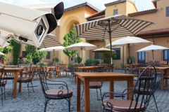 CCTV Security Camera operating in the restaurant blur backgroun Royalty Free Stock Photo